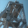 三池炭鉱万田坑。19メートルの鉄鋼製櫓は2009年に保存修理が実施されました。鋼材は英国のドーマンロング社から主に輸入され、同社製の鋼材は九州の鉄道線路にも使われていました。